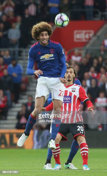 Marouane Fellaini of Manchester United in action with Manolo Gabbiani of Southampton during the Premier League match between Southampton and...