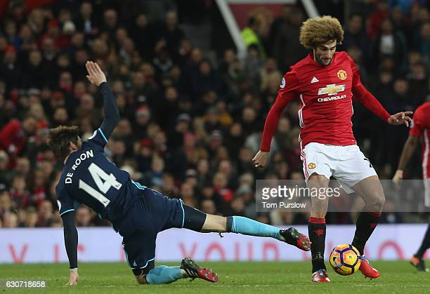 Marouane Fellaini of Manchester United in action with Marten de Roon of Middlesbrough during the Premier League match between Manchester United and...