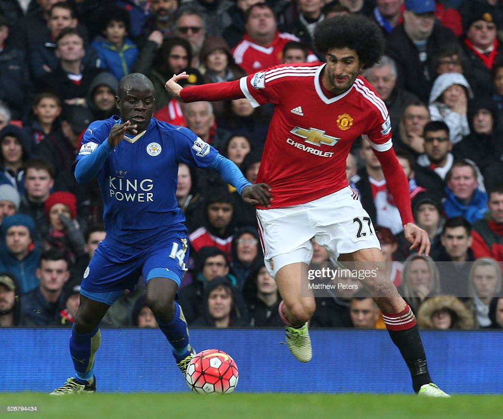 <a gi-track='captionPersonalityLinkClicked' href=/galleries/search?phrase=Marouane+Fellaini&family=editorial&specificpeople=3936316 ng-click='$event.stopPropagation()'>Marouane Fellaini</a> of Manchester United in action with Ngolo Kante of Leicester City during the Barclays Premier League match between Manchester United and Leicester City at Old Trafford on May 1, 2016 in Manchester, England.