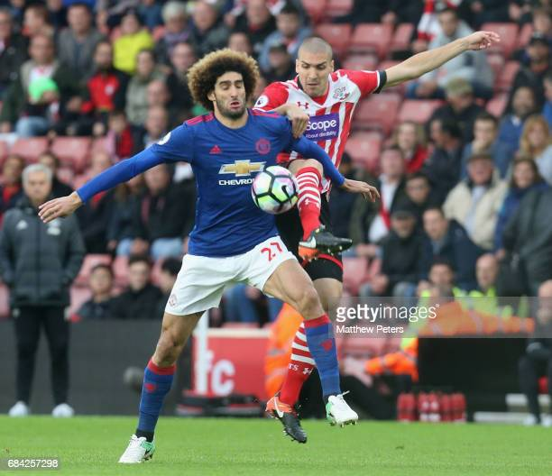 Marouane Fellaini of Manchester United in action with Oriol Romeu of Southampton during the Premier League match between Southampton and Manchester...