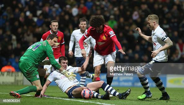 Marouane Fellaini of Manchester United in action with Thorsten Stuckmann and Tom Clarke of Preston North End during the FA Cup Fifth Round match...