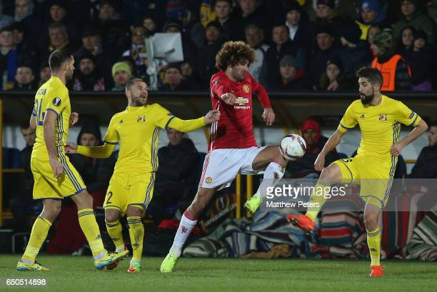 Marouane Fellaini of Manchester United in action with Timofei Kalachev and Miha Mevlja of FK Rostov during the UEFA Europa League Round of 16 first...
