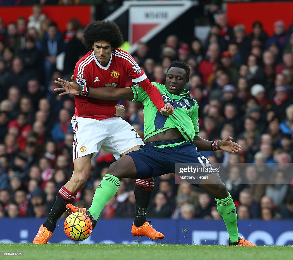 Marouane Fellaini of Manchester United in action with Victor Wanyama of Southampton during the Barclays Premier League match between Manchester United and Southampton at Old Trafford on January 23, 2016 in Manchester, England.