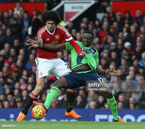 Marouane Fellaini of Manchester United in action with Victor Wanyama of Southampton during the Barclays Premier League match between Manchester...