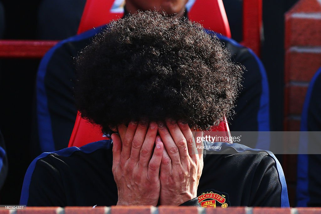 Marouane Fellaini of Manchester United is seen on the substitutes bench before the Barclays Premier League match between Manchester United and West Bromwich Albion at Old Trafford on September 28, 2013 in Manchester, England.