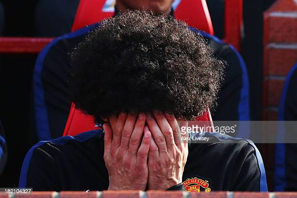 Marouane Fellaini of Manchester United is seen on the substitutes bench before the Barclays Premier League match between Manchester United and West...