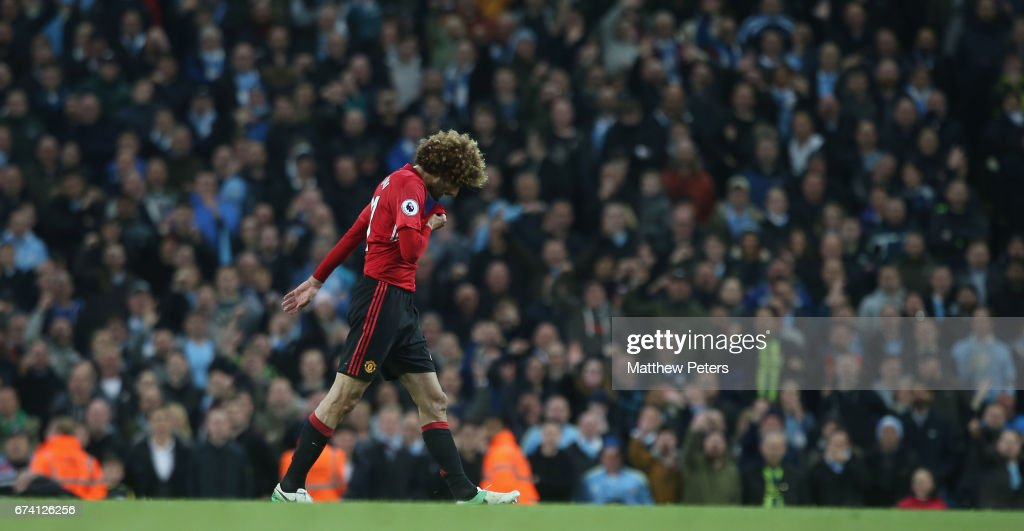 Marouane Fellaini of Manchester United is sent off by Referee Martin Atkinson after clashing with Sergio Aguero of Manchester City during the Premier League match between Manchester City and Manchester United at Etihad Stadium on April 27, 2017 in Manchester, England.