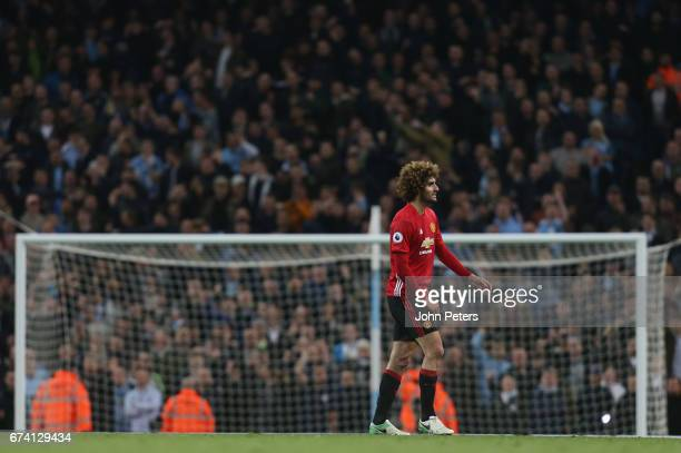 Marouane Fellaini of Manchester United is sent off by Referee Martin Atkinson after clashing with Sergio Aguero of Manchester City during the Premier...