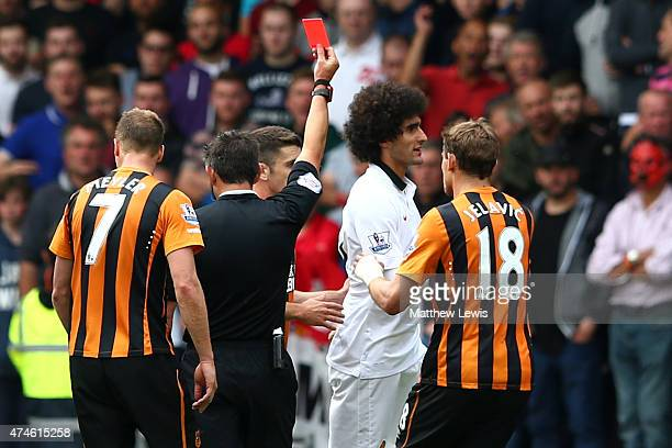 Marouane Fellaini of Manchester United is shown a red card by referee Lee Probert during the Barclays Premier League match between Hull City and...