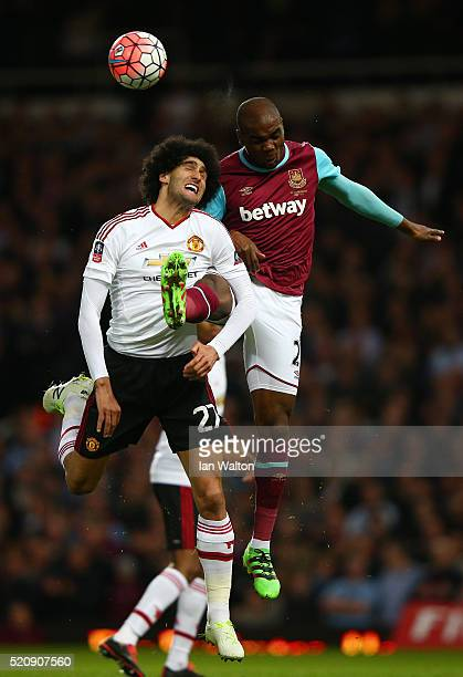 Marouane Fellaini of Manchester United jumps for a header with Angelo Ogbonna of West Ham United during the Emirates FA Cup sixth round replay...
