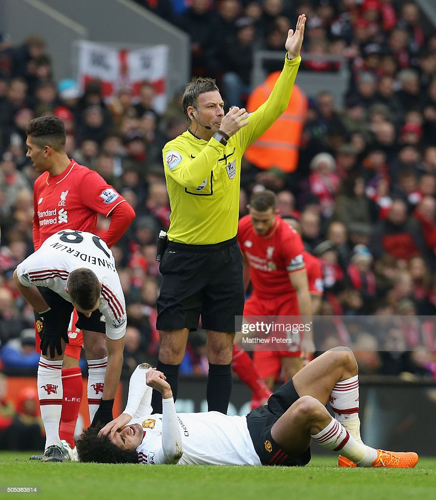 Marouane Fellaini of Manchester United lies injured after a clash of heads with Lucas of Liverpool during the Barclays Premier League match between Liverpool and Manchester United at Anfield on January 17 2016 in Liverpool, England.