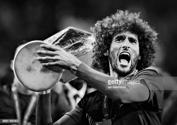 Marouane Fellaini of Manchester United lifts the trophy during the UEFA Europa League Final match between Ajax and Manchester United at Friends Arena...