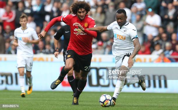 Marouane Fellaini of Manchester United marks Jordan Ayew of Swansea City during the Premier League match between Swansea City and Manchester United...