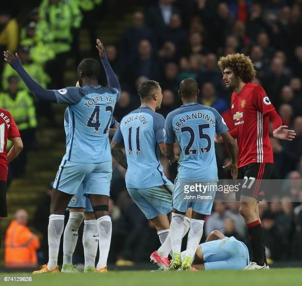 Marouane Fellaini of Manchester United pleads his innocence after clashing with Sergio Aguero of Manchester City during the Premier League match...