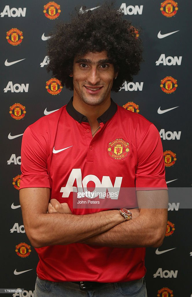 <a gi-track='captionPersonalityLinkClicked' href=/galleries/search?phrase=Marouane+Fellaini&family=editorial&specificpeople=3936316 ng-click='$event.stopPropagation()'>Marouane Fellaini</a> of Manchester United poses in a Manchester United shirt after signing for the club at Aon Training Complex on September 2, 2013 in Manchester, England.
