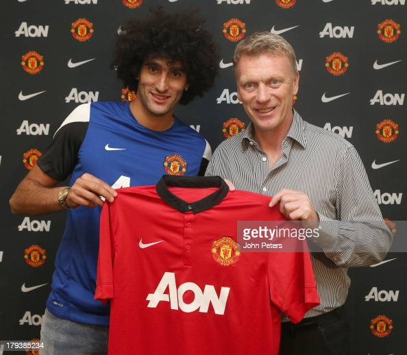 Marouane Fellaini of Manchester United poses with Manager David Moyes after signing for the club at Aon Training Complex on September 2 2013 in...