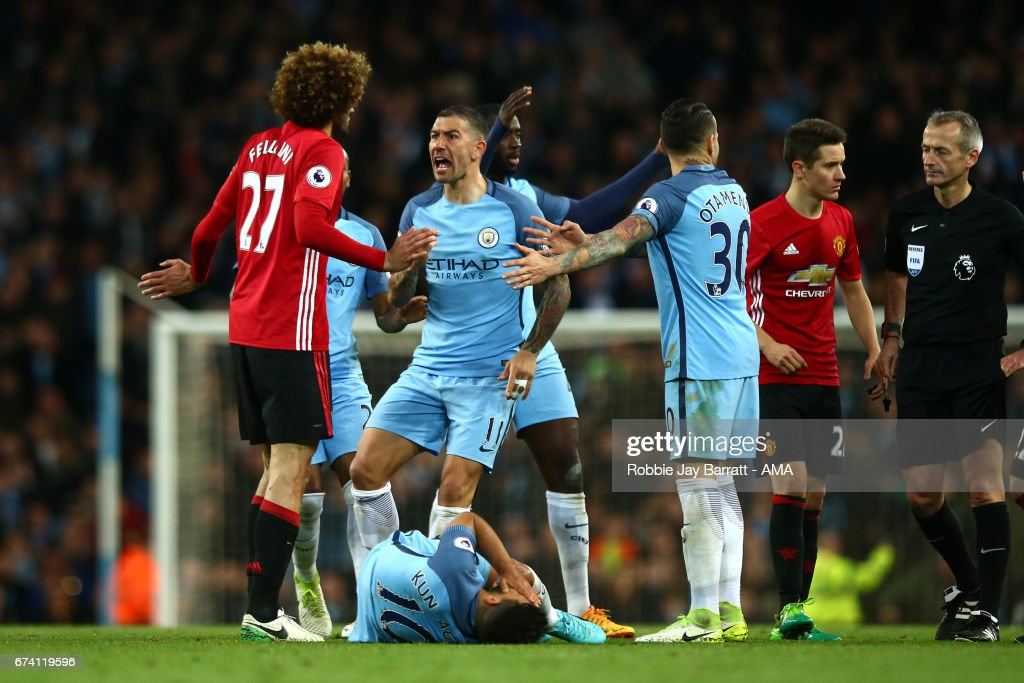 Marouane Fellaini of Manchester United reacts after clashing heads with Sergio Aguero of Manchester City during the Premier League match between Manchester City and Manchester United at Etihad Stadium on April 27, 2017 in Manchester, England.