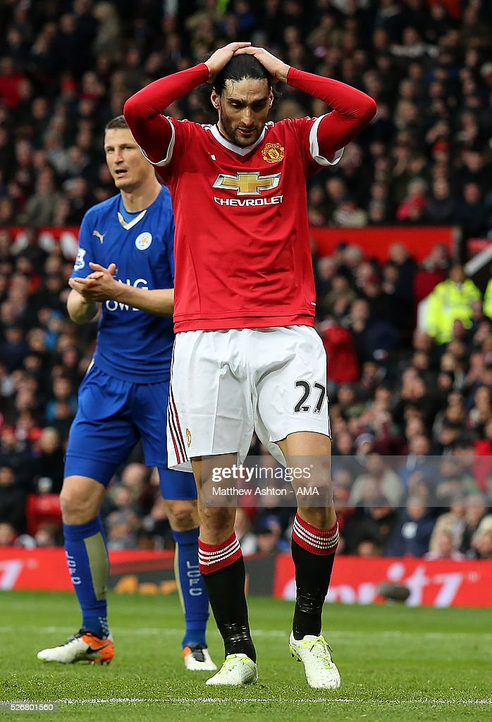 <a gi-track='captionPersonalityLinkClicked' href=/galleries/search?phrase=Marouane+Fellaini&family=editorial&specificpeople=3936316 ng-click='$event.stopPropagation()'>Marouane Fellaini</a> of Manchester United reacts during the Barclays Premier League match between Manchester United and Leicester City at Old Trafford on May 1, 2016 in Manchester, United Kingdom.