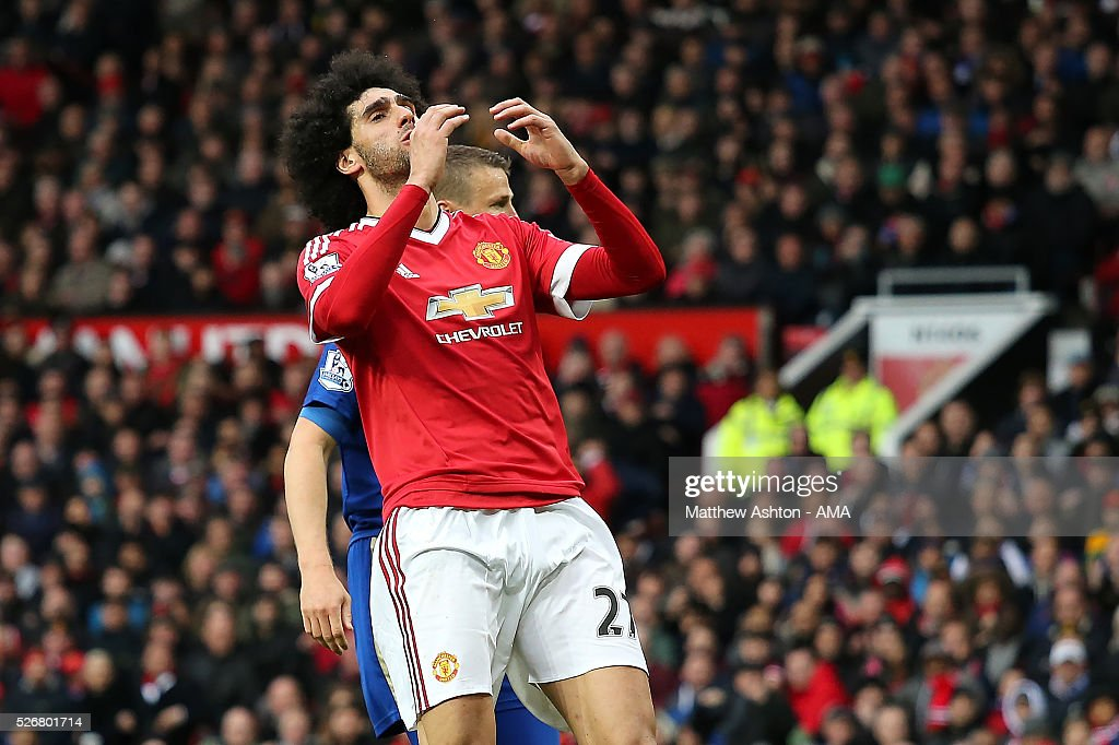 <a gi-track='captionPersonalityLinkClicked' href=/galleries/search?phrase=Marouane+Fellaini&family=editorial&specificpeople=3936316 ng-click='$event.stopPropagation()'>Marouane Fellaini</a> of Manchester United reacts to a missed chance during the Barclays Premier League match between Manchester United and Leicester City at Old Trafford on May 1, 2016 in Manchester, United Kingdom.