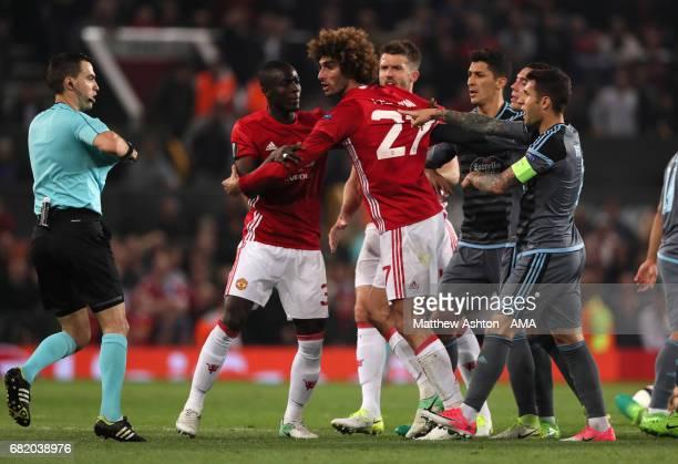 Marouane Fellaini of Manchester United reacts to Referee Ovidiu Hategan during the UEFA Europa League semi final second leg match between Manchester...