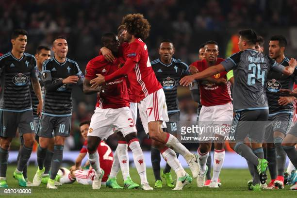 Marouane Fellaini of Manchester United restrains Eric Bailly during the UEFA Europa League semi final second leg match between Manchester United and...