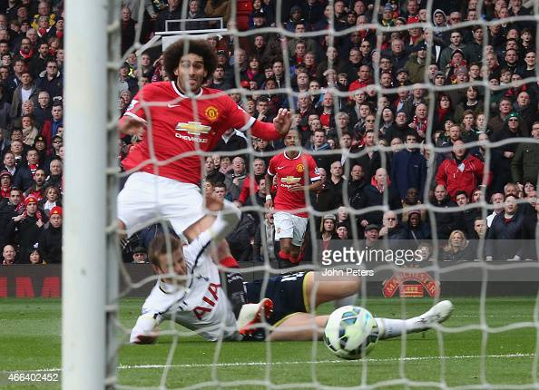 Marouane Fellaini of Manchester United scores their first goal during the Barclays Premier League match between Manchester United and Tottenham...