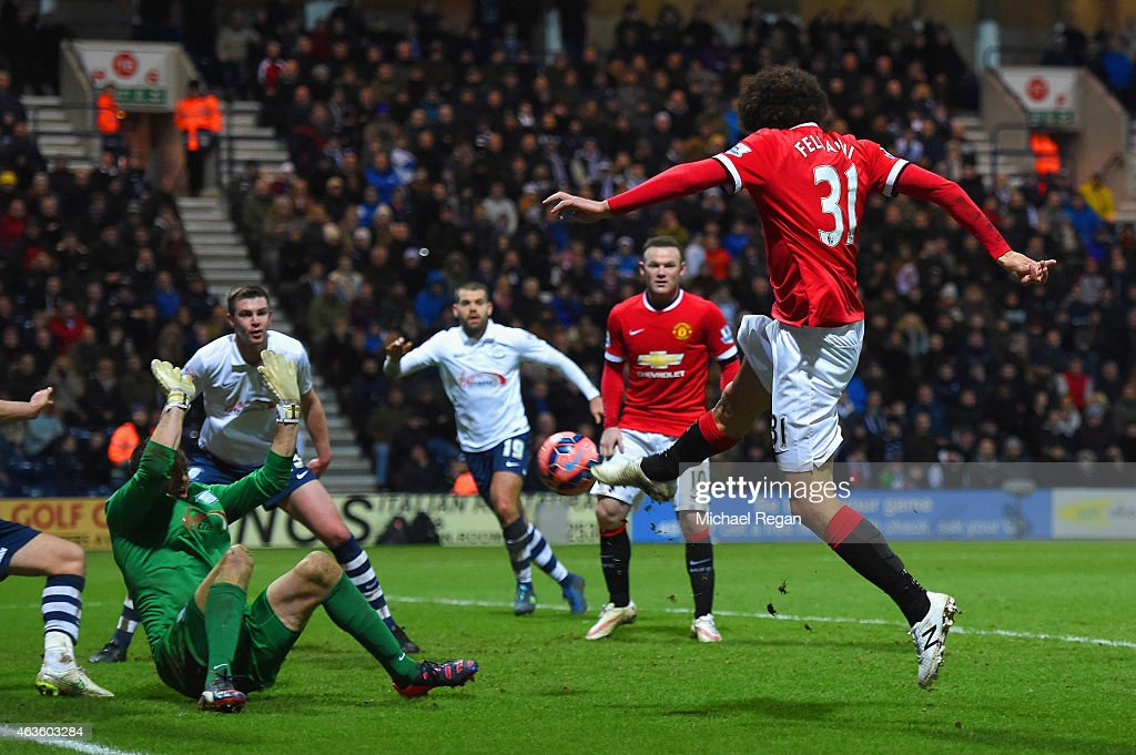 Marouane Fellaini of Manchester United scores their second goal past Thorsten Stuckmann of Preston North End during the FA Cup Fifth round match...