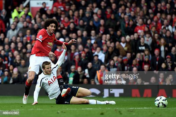 Marouane Fellaini of Manchester United shoots past Eric Dier of Spurs to score the opening goal during the Barclays Premier League match between...