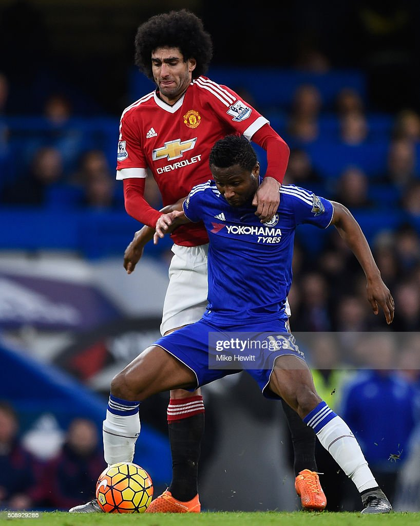 Marouane Fellaini of Manchester United tackles John Mikel Obi of Chelsea during the Barclays Premier League match between Chelsea and Manchester United at Stamford Bridge on February 7, 2016 in London, England.