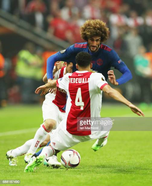 Marouane Fellaini of Manchester United vies with Jairo Riedewald of Ajax during the UEFA Europa League Final match between Ajax and Manchester United...