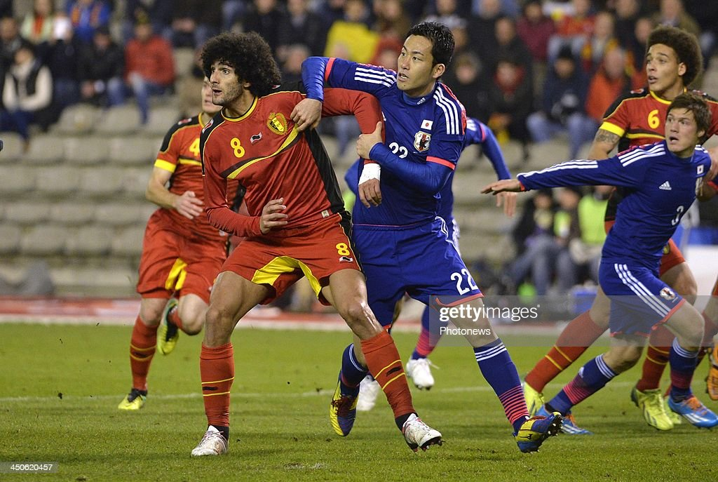 Marouane Fellaini of Manchester United - Yoshida Maya of Southampton FC (England) pictured during the international friendly match before the World Cup in Brasil between Belgium and Japan on November 19, 2013 in Brussels, Belgium