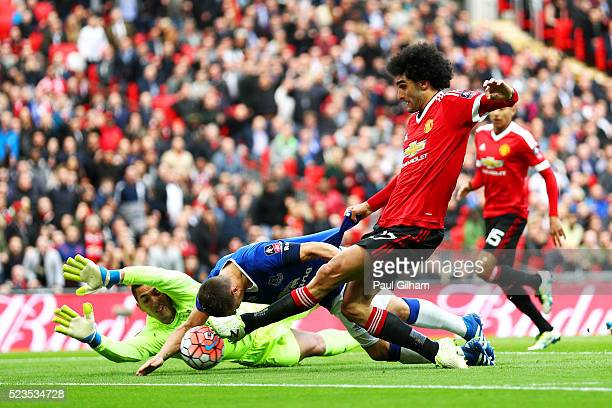 Marouane Fellaini of Manchester United's shot is blocked by Phil Jagielka and Joel Robles of Everton during The Emirates FA Cup semi final match...