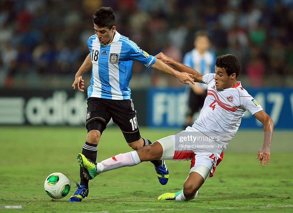 Marouane Sahraoui of Tunisia tackles Luis Leszczuk of Argentina during the FIFA U-17 World Cup UAE 2013 round of 16 match between Argentina and Tunisia at the Rashid Stadium on October 29, 2013 in Dubai, United Arab Emirates.