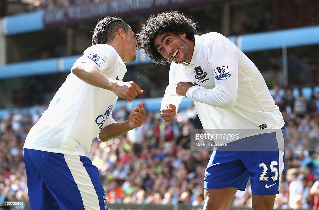 Maroune Fellaini (R) of Everton celebrates his goal with team mate <a gi-track='captionPersonalityLinkClicked' href=/galleries/search?phrase=Steven+Pienaar&family=editorial&specificpeople=787271 ng-click='$event.stopPropagation()'>Steven Pienaar</a> during the Barclays Premier league match between Aston Villa and Everton at Villa Park on August 25, 2012 in Birmingham, England.