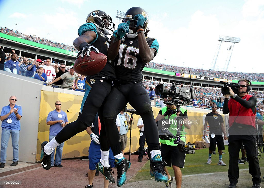 Marqise Lee and Denard Robinson of the Jacksonville Jaguars celebrate after Lee scores a touchdown during the second half of the game against the New...