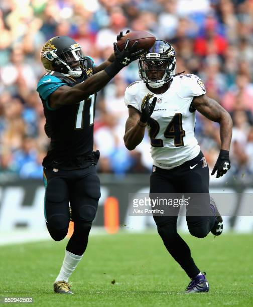 Marqise Lee of the Jacksonville Jaguars catches the ball under pressure from Brandon Carr of the Baltimore Ravens during the NFL International Series...