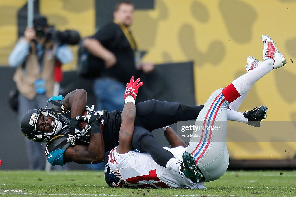 Marqise Lee of the Jacksonville Jaguars is stopped by Dominique RodgersCromartie of the New York Giants during the first half of the game at EverBank...