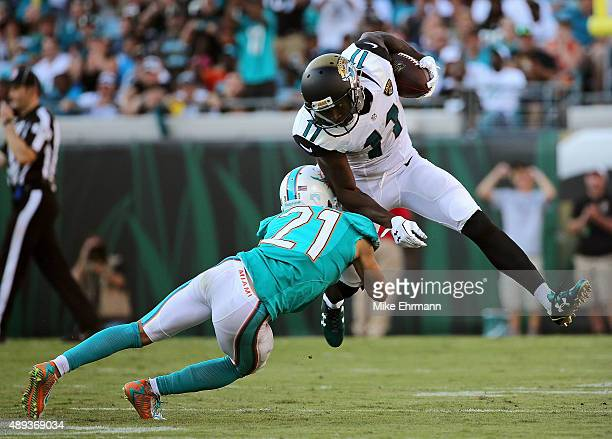 Marqise Lee of the Jacksonville Jaguars is tackled by Brent Grimes of the Miami Dolphins during a game at EverBank Field on September 20 2015 in...