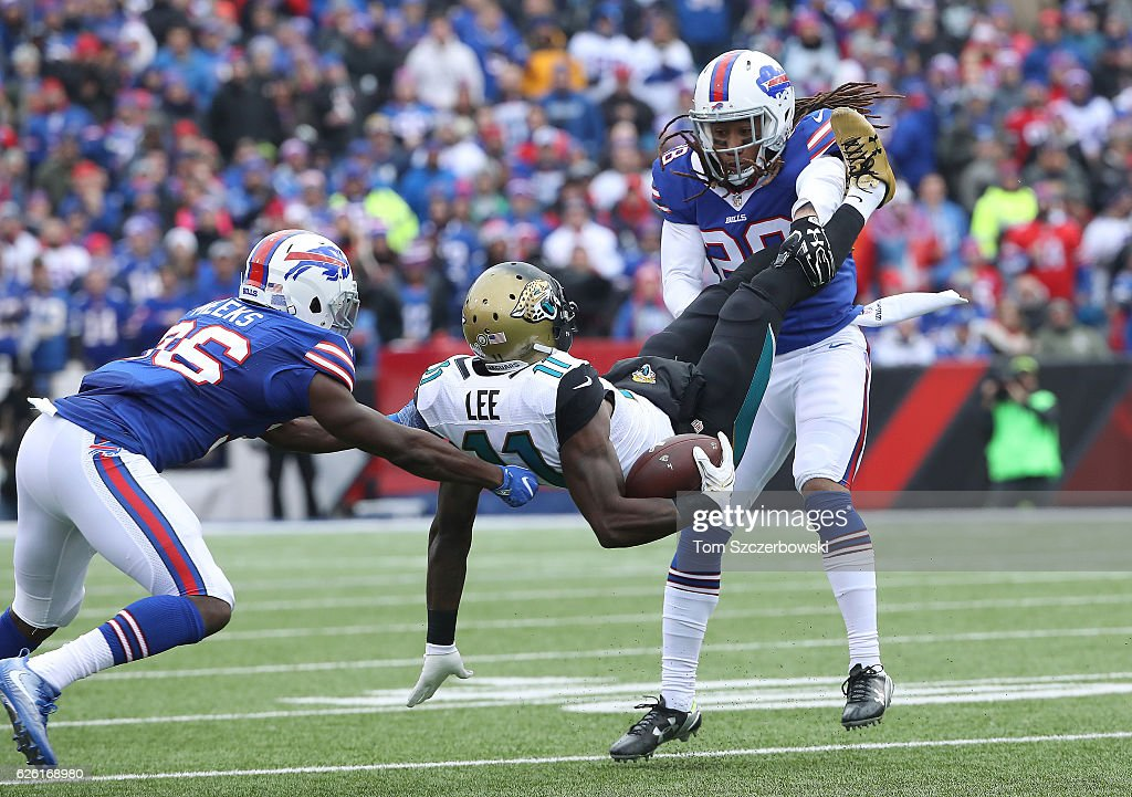 Marqise Lee #11 of the Jacksonville Jaguars is tackled by Ronald Darby #28 of the Buffalo Bills and Jonathan Meeks #36 during NFL game action at New Era Field on November 27, 2016 in Orchard Park, New York.