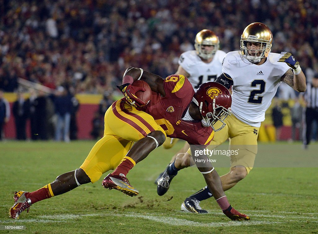 Marqise Lee #9 of the USC Trojans keeps his balance after a catch as Bennett Jackson #2 of the Notre Dame Fighting Irish defends during a 22-13 Notrre Dame win at Los Angeles Memorial Coliseum on November 24, 2012 in Los Angeles, California.