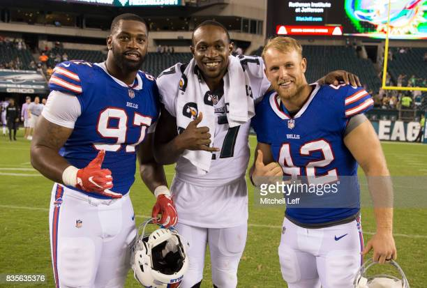 Marquavius Lewis and Patrick DiMarco of the Buffalo Bills pose for a picture with Alshon Jeffery of the Philadelphia Eagles after the preseason game...