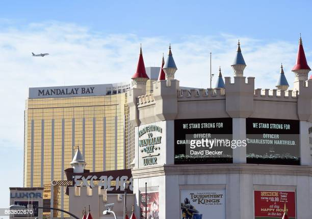 Marquees display support for Las Vegas Metropolitan Police Department Officer Charleston Hartfield during a motorcade on the Las Vegas Strip...