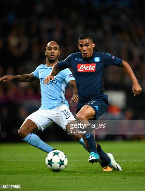 Marques Allan of SSC Napoli attempts to get past Fabian Delph of Manchester City during the UEFA Champions League group F match between Manchester...