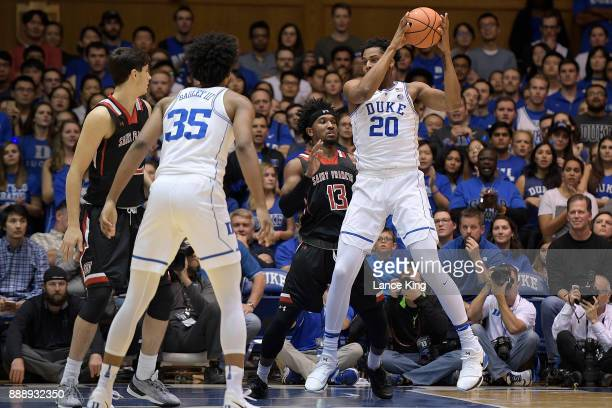 Marques Bolden of the Duke Blue Devils controls the ball against Keith Braxton of the St Francis Red Flash at Cameron Indoor Stadium on December 5...