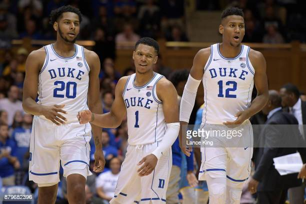 Marques Bolden Trevon Duval and Javin DeLaurier of the Duke Blue Devils react following a play during their game against the Southern Jaguars at...