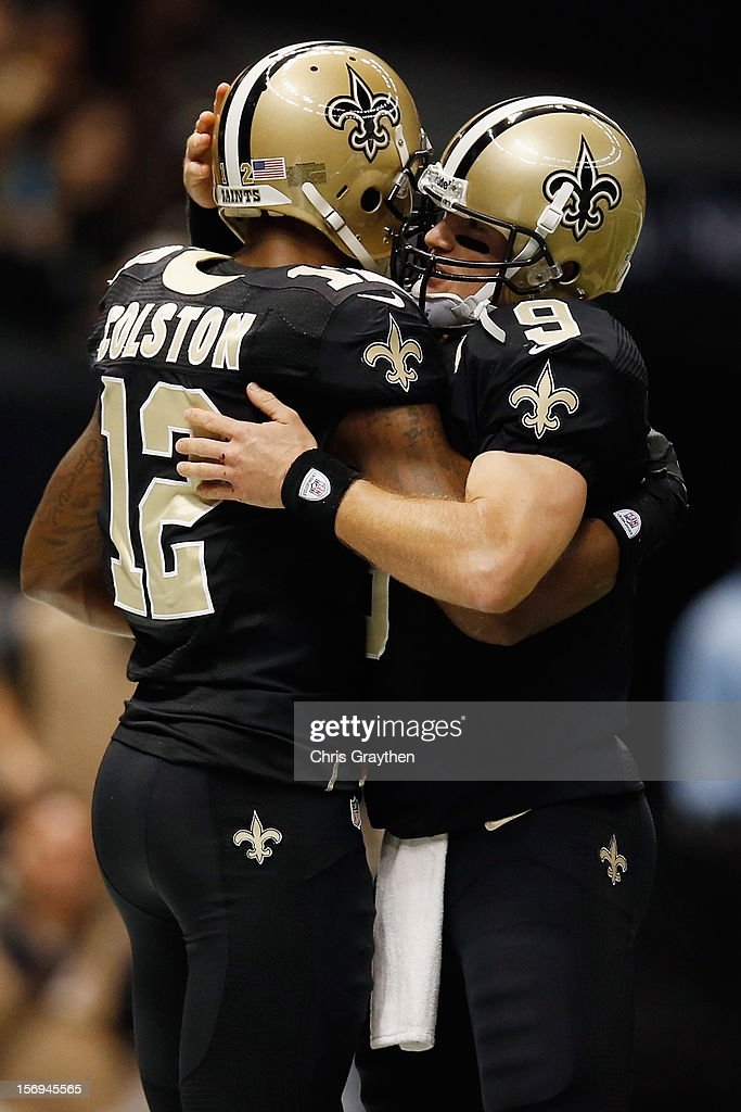 Marques Colson #12 and Drew Brees #9 of the New Orleans Saints celebrate after scoring a touchdown against the San Francisco 49ers at The Mercedes-Benz Superdome on November 25, 2012 in New Orleans, Louisiana.