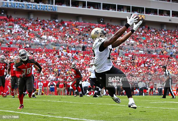 Marques Colston of the New Orleans Saints catches a touchdown pass during the second quarter of the game against the Tampa Bay Buccaneers at Raymond...