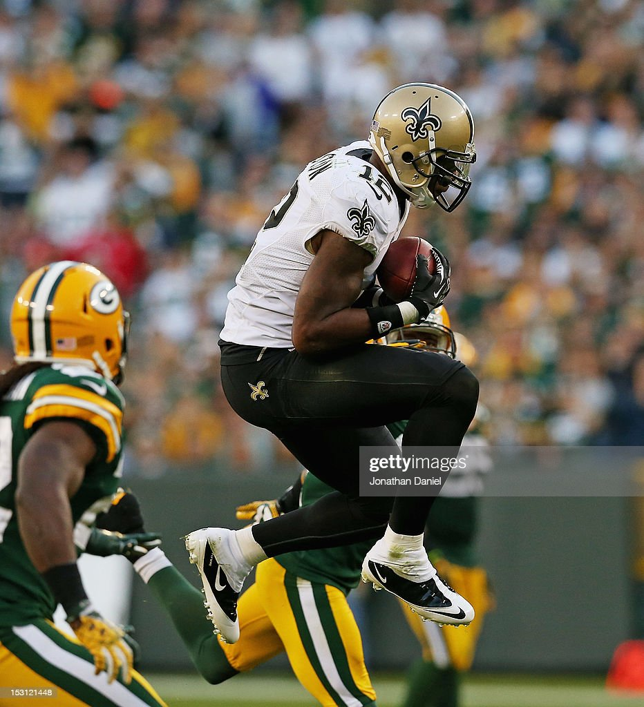 Marques Colston #12 of the New Orleans Saints leaps to make a catch against the Green Bay Packers at Lambeau Field on September 30, 2012 in Green Bay, Wisconsin. The Packers defeated the Saints 28-27.
