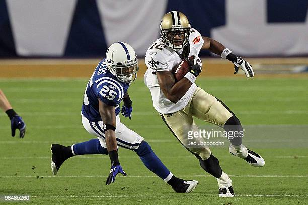 Marques Colston of the New Orleans Saints runs with the ball against Jerraud Powers of the Indianapolis Colts during Super Bowl XLIV on February 7...