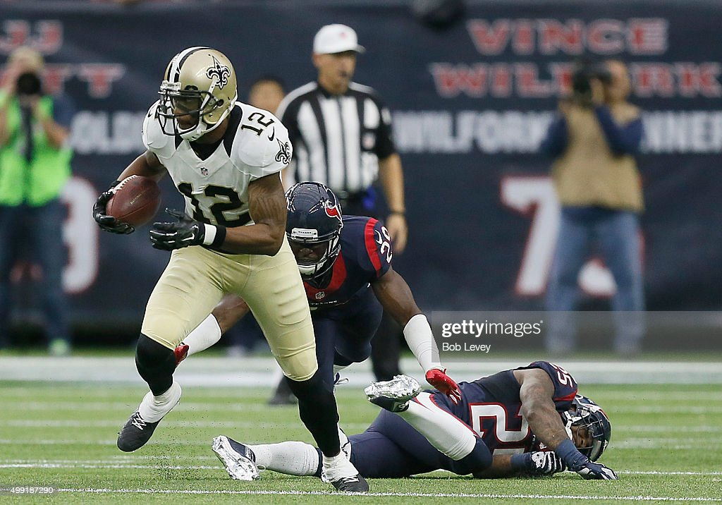 <a gi-track='captionPersonalityLinkClicked' href=/galleries/search?phrase=Marques+Colston&family=editorial&specificpeople=741430 ng-click='$event.stopPropagation()'>Marques Colston</a> #12 of the New Orleans Saints rushes past <a gi-track='captionPersonalityLinkClicked' href=/galleries/search?phrase=Andre+Hal&family=editorial&specificpeople=8281332 ng-click='$event.stopPropagation()'>Andre Hal</a> #29 and <a gi-track='captionPersonalityLinkClicked' href=/galleries/search?phrase=Kareem+Jackson&family=editorial&specificpeople=3908085 ng-click='$event.stopPropagation()'>Kareem Jackson</a> #25 of the Houston Texans in the second quarter on November 29, 2015 at NRG Stadium in Houston, Texas.